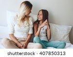 mom with her tween daughter... | Shutterstock . vector #407850313