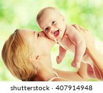 mother with baby outdoors.... | Shutterstock . vector #407914948