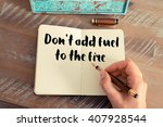 Small photo of Handwritten quote Don't add fuel to the fire as inspirational concept image