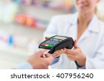 paying in the pharmacy  | Shutterstock . vector #407956240