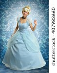 Small photo of Portrait of beautiful woman dressed in princess costume over magical background