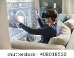 man sitting on sofa at home... | Shutterstock . vector #408018520
