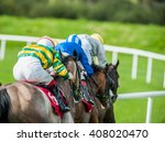 Stock photo race horses and jockeys racing down the track 408020470