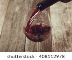 Small photo of Alcoholic drink. Red wine pouring