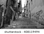 Narrow City Street With Stairs...