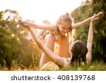mother lying down on grass and... | Shutterstock . vector #408139768