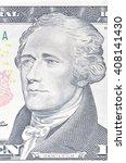 Small photo of Alexander Hamilton portrait on ten dollar bill macro, 10 usd, united states money closeup