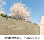 "Small photo of WASHINGTON, DC - MARCH 26, 2016: Cherry blossoms adorn the ""Peace on Earth"" quote, on Inscription Wall, at the Martin Luther King, Jr. Memorial, in Potomac Park, Washington, DC. Sculptor: Lei Yixin"