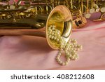 saxophone and pearl necklace on ... | Shutterstock . vector #408212608