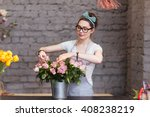 beautiful young woman florist... | Shutterstock . vector #408238219