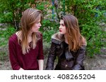 two young girls sitting in the... | Shutterstock . vector #408265204
