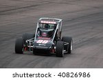 """Small photo of AVONDALE, AZ - NOVEMBER 12: Cameron Dodson works to qualify his car well for the """"Copper World Classic"""" race at Phoenix International Raceway on November 12, 2009 in Avondale, AZ."""