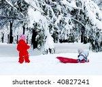 girl pulling her little brother ... | Shutterstock . vector #40827241