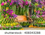wood chair in the flowers... | Shutterstock . vector #408343288