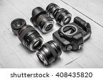 camera lenses laying on white... | Shutterstock . vector #408435820
