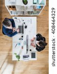 top view. two colleagues  one... | Shutterstock . vector #408464329