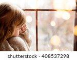 girl is sitting near the window ... | Shutterstock . vector #408537298