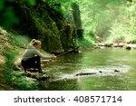 young woman splash water | Shutterstock . vector #408571714