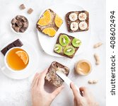 woman hands spreading peanut... | Shutterstock . vector #408602494