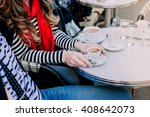 french couple holding hands in... | Shutterstock . vector #408642073
