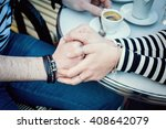 french couple holding hands in... | Shutterstock . vector #408642079