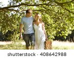 a young couple carrying a... | Shutterstock . vector #408642988