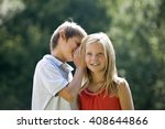 a young boy whispering to a... | Shutterstock . vector #408644866