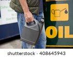 a senior man holding an oil... | Shutterstock . vector #408645943