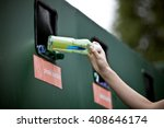 A Teenage Girl Recycling A...