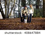 a young couple helping their... | Shutterstock . vector #408647884