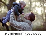 a father lifting his son in the ... | Shutterstock . vector #408647896