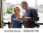 a middle aged couple standing...   Shutterstock . vector #408648748
