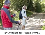 a mature couple walking along a ... | Shutterstock . vector #408649963