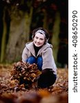 a woman gathering leaves in...   Shutterstock . vector #408650290