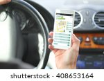 driver holding smartphone with... | Shutterstock . vector #408653164