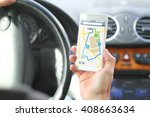 driver holding smartphone with... | Shutterstock . vector #408663634
