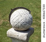 Small photo of Stone spherical sundial at the Chateau de la Brede, which is a feudal castle in the department of Gironde, France.The philosopher Montesquieu was born, lived and wrote the majority of his works here.