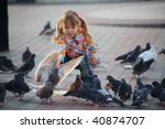Child Playing With Doves In Th...
