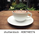 cup of coffee on table in...   Shutterstock . vector #408748576
