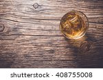 glass of whiskey on an old... | Shutterstock . vector #408755008