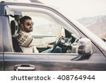 young man drives a car in... | Shutterstock . vector #408764944