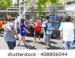 Small photo of Bangkok, Thailand - APR 13, 2012: Songkran Festival in Khao San Road. A moment of Thai people and foreigner celebrate this famous event together. These photos are taken by camera in a water-proof bag.