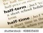 Small photo of Close up of old English dictionary page with word half term