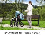 woman with pram while taking a...   Shutterstock . vector #408871414