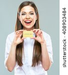 Small photo of Advertising of payment systems with beautiful woman holding credit bank card. Isolated portrait of smiling female model.