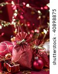 Christmas decoration (Red christmas sacks, gift boxes, balls) on a red silky background - stock photo