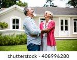 happy senior couple hugging...   Shutterstock . vector #408996280