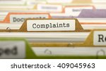 Stock photo complaints concept on file label in multicolor card index closeup view selective focus d render 409045963