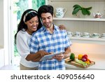 young couple using digital... | Shutterstock . vector #409056640