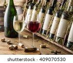 wine bottles on the wooden... | Shutterstock . vector #409070530